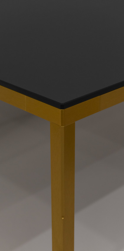 Milan Design Week 2019 | FILA table by Plank in Golden Steel and FENIX NTM Nero Ingo. Design Konstantin Grcic.